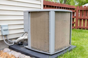 dirty outdoor HVAC unit needs to be cleaned to work properly