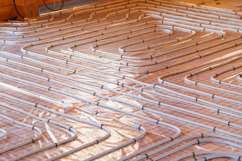 image of hot water tubes being placed for underfloor radiant heating