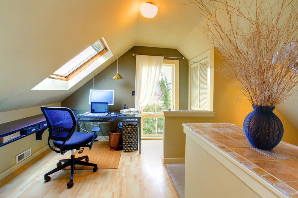 attic office space with blue decor