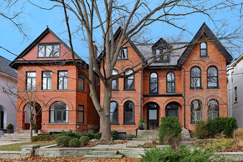 a row of victorian homes showing third floor living spaces
