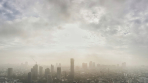 smog settling over an industrial city